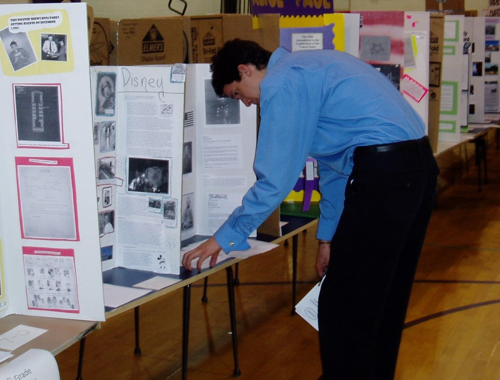A student serving as a National History Day Judge at a local school.
